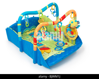 Colorful play mat with toys for babies. Isolated on white background. - Stock Photo