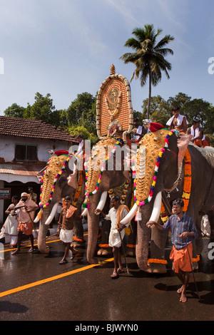 India, Kerala, Thrissur, procession of three caparisoned ...