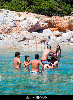 Young Turkish men and women playing in the sea near Bodrum, Turkey, Eurasia, Asia Minor. - Stock Photo