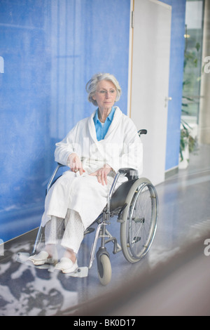 Old woman in a wheel chair - Stock Photo