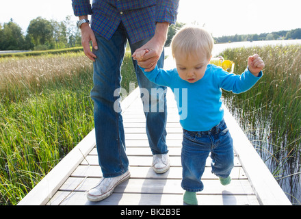 Firsts steps of a baby boy - Stock Photo