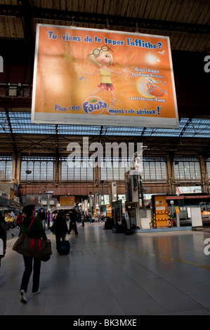 Paris, France, People in 'Gare d'Austerlitz' Train Station, Billboard, French Advertising Soft Drinks - Stock Photo