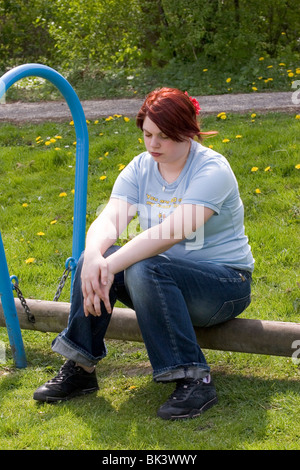http://n450v.alamy.com/450v/bk3wwy/plus-sized-young-woman-sit-in-park-thinking-looking-down-sad-and-lonely-bk3wwy.jpg