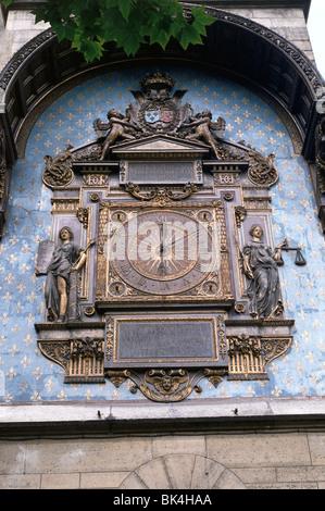 Wall clock on the Tour de l'Horloge of the Conciergerie, Paris - Stock Photo