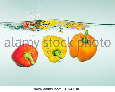 Bell peppers splashing in water - Stock Photo
