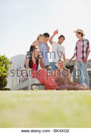 Friends enjoying barbecue - Stock Photo