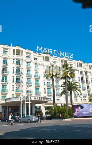 Cannes , La Croisette , the luxury art deco Martinez hotel entrance with frontage & balconies & palm trees & deep - Stock Photo
