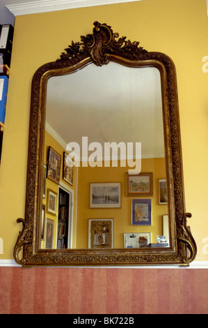 Old Baroque Style French Antique Mirror, on Wall in Living Room, Paris, France - Stock Photo
