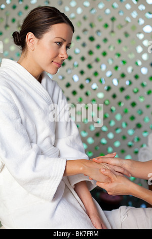Woman having hand massage - Stock Photo