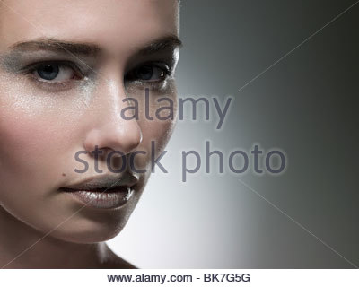 Young woman with silver make up on face - Stock Photo