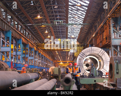Engineers In Steel Factory With Lathe - Stock Photo