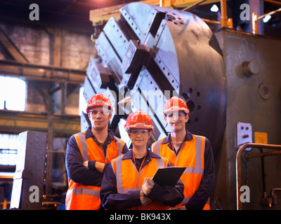 Steel Engineers In Front Of Lathe - Stock Photo