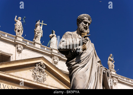 Fascade of St. Peter's Basilica, Statue of Saint Peter in foreground, Vatican City, Rome, Italy - Stock Photo