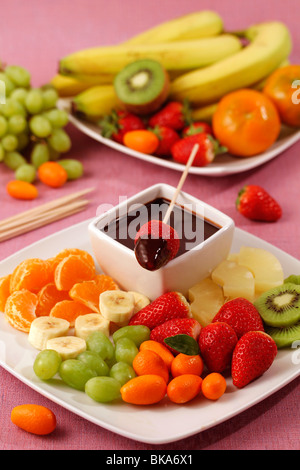 Fruit skewers with chocolate. Recipe available. - Stock Photo