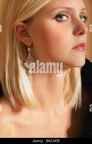 Woman With Long Earrings - Stock Photo