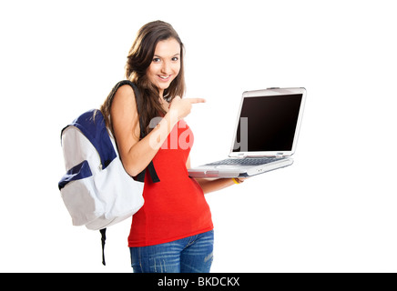 Beautiful young female student showing something on a laptop, isolated on white - Stock Photo
