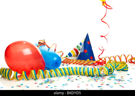 party decoration - balloons, party hats, streamers, confetti - Stock Photo