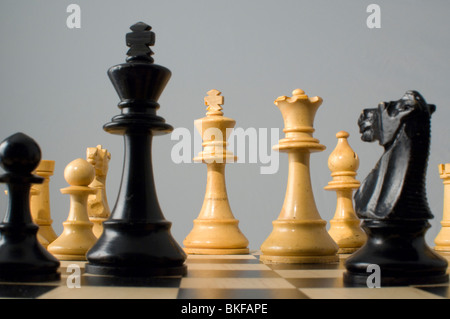 Chess. Checkmate. Various chess pieces on chess board - Stock Photo