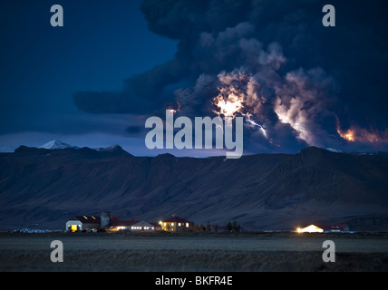Lightning in ash cloud during Eyjafjallajokull Volcanic, Eruption with Dalsel Farm, Iceland - Stock Photo