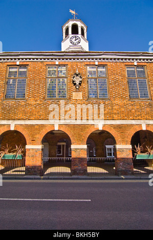 Vertical wide angle view of the prominent red brick Market Hall in Old Amersham High Street on a sunny day. - Stock Photo
