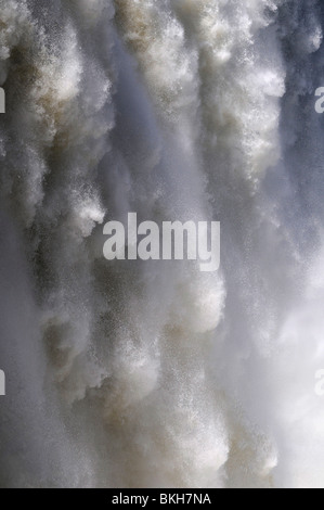 Close-up of rushing water at the Iguazu waterfalls, at the border between Argentina and Brazil. - Stock Photo
