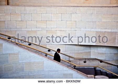 Man walking down stairs on Union Station, Los Angeles, California - Stock Photo