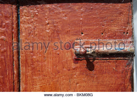 Garden Shed - Bolt, Open Door and distressed paint, Swainby, North Yorkshire - Stock Photo