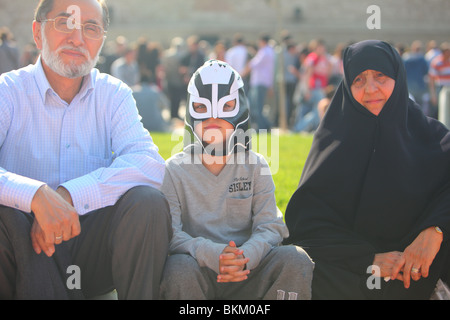 super hero with veiled elderly muslim woman, Turkey, Istanbul - Stock Photo