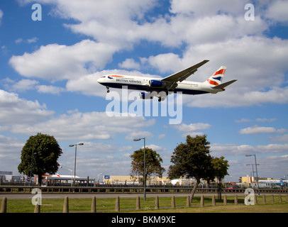 Low flying plane landing at London Heathrow airport - Stock Photo