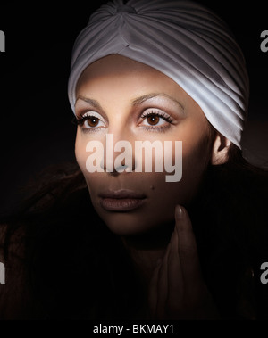 Light falling on a beautiful woman face artistic portrait - Stock Photo