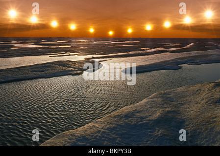 Midnight Sun Multiple Exposure Arctic Alaska Ice Floating Summer Sunset - Stock Photo