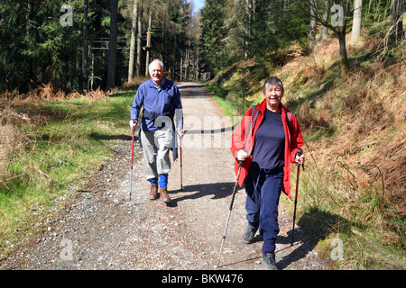 Active elderly people go hill walking in the Trossachs National Park, Scotland - Stock Photo