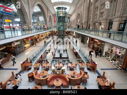 Interior of large atrium at Leipzig railway station or Hauptbahnhof in Leipzig Germany - Stock Photo