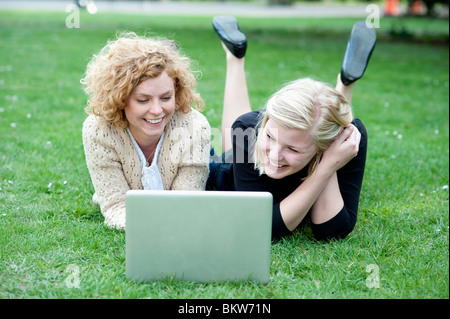 Two girls with a laptop - Stock Photo