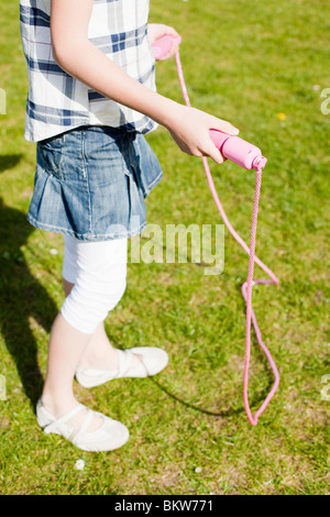 Girl with skipping rope - Stockfoto