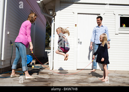 Girl jumping the rope - Stockfoto