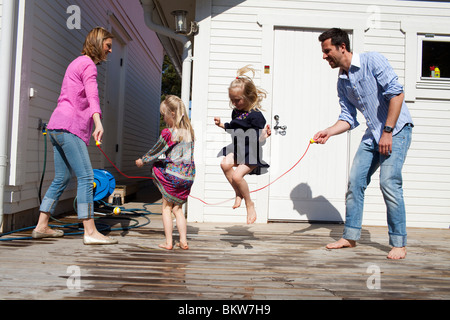 Family jumping the rope - Stockfoto