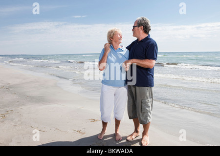 Elderly couple standing by the water - Stock Photo
