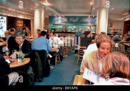 PARIS, France - People Eating Lunch in Trendy Café-Bistro Restaurant in Lanvin Store Basement, 'Le Café Bleu'. - Stock Photo