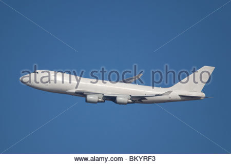 Boeing 747 on the blue sky background, - Stock Photo