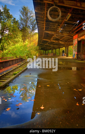 An old S-Bahn station unused since the 80s near Berlin with reflections in water - Stock Photo