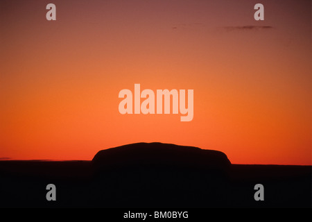Uluru, Ayers Rock, Silhouette at Sunrise, Uluru-Kata Tjuta National Park, Northern Territory, Australia - Stock Photo