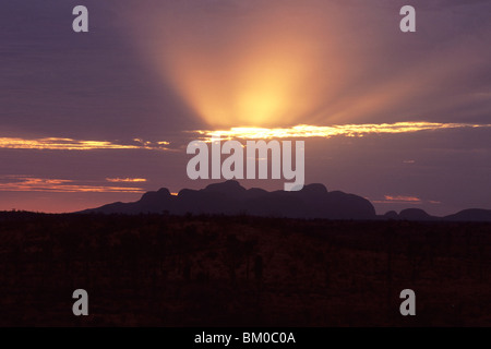 Halo Sunset over Kata-Tjuta, The Olgas, Uluru-Kata Tjuta National Park, Northern Territory, Australia - Stock Photo