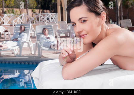 Close-up of a woman smelling lavender flowers - Stock Photo