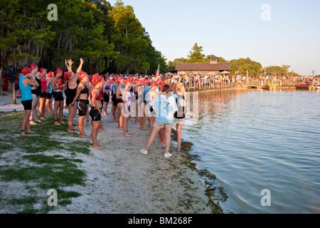 Orlando, FL - May 2009 - Women prepare to compete in the swimming portion of the Danskin Triathlon Series in Orlando - Stock Photo