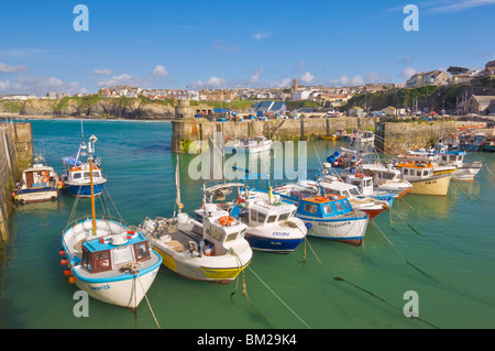 Small fishing boats in the harbour at high tide, Newquay, North Cornwall, UK - Stock Photo