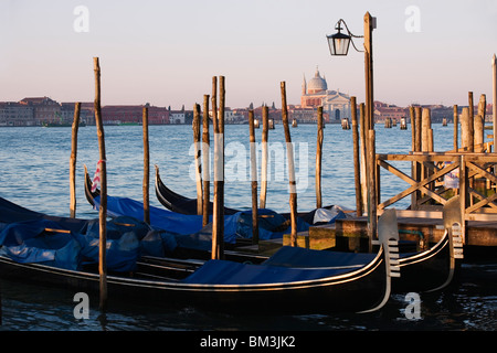 Venice - View across the Grand Canal from San Marco towards Santa Maria della Salute with Gondolas moored in the - Stock Photo