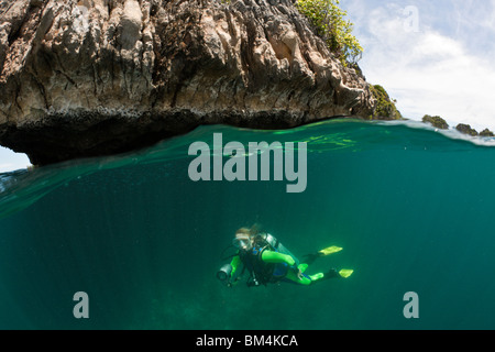 Scuba Diver in Shallow, Raja Ampat, West Papua, Indonesia - Stock Photo