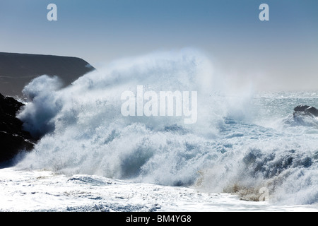 Heavy Atlantic seas with large waves crashing onto the beach at Ajuy on the Canary Island of Fuerteventura - Stock Photo