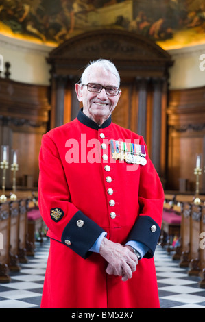 Portrait of In-Pensioner John Ley dressed in his scarlet coat in Chapel of the Royal Hospital Chelsea in London, - Stock Photo
